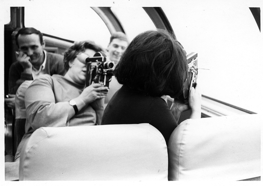 Photographs of Wendy Michener and family : Image of Wendy Michener (holding film camera) and Joyce Wieland (with back to camera). [1969]York University Library, Clara Thomas Archives & Special Collections, Joyce Wieland fonds, ASC07123